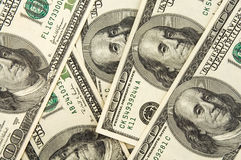 Dollars. Real one hundred dollars banknote background texture Stock Image