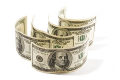 Dollars. Five one hundred dollars banknotes standing on the white Royalty Free Stock Images
