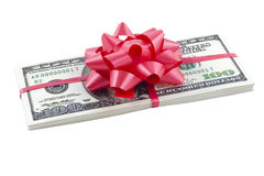 Dollars. Pack of dollars tied up by a red tape Royalty Free Stock Images