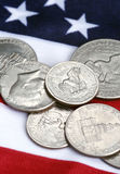 Dollars. Coins and flag royalty free stock image