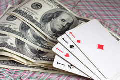 Dollars and 4 aces Royalty Free Stock Photos