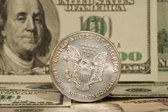 Dollars. The American silver dollar on a background of bank-paper royalty free stock images