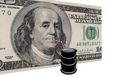 Dollars américains buvant le pétrole Images stock