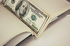 Dollars américains d'argent Images stock