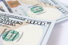 Dollars américains d'argent d'argent liquide sur le fond blanc photographie stock