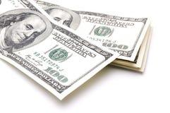 Dollars américains d'argent liquide sur un fond blanc Images stock