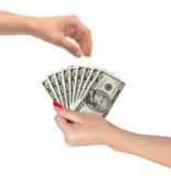 Dollars américains dans femmes main et main d'homme d'isolement sur le blanc Photos stock