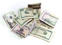Dollars américains sur le blanc Images stock