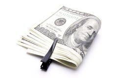 Dollars américains sur un fond blanc Photo libre de droits