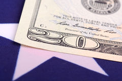 Dollars on american flag. Business and financial concept Royalty Free Stock Images