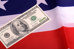 Dollars on american flag. Business and financial concept Royalty Free Stock Photo