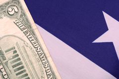 Dollars on american flag Stock Photo