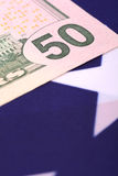 Dollars on american flag. Close up Royalty Free Stock Photos