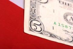 Dollars on american flag. Five dollars on american flag Royalty Free Stock Image