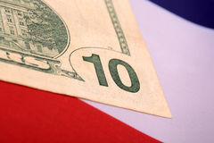 Dollars on american flag. Ten dollars on american flag Royalty Free Stock Photos