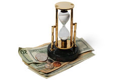 Dollars And An Hourglass Royalty Free Stock Photos