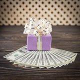 Dollars anf gift box Stock Photos