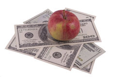 Dollars with apple. Isolated on the white Stock Image