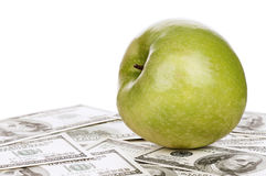 Dollars and apple Royalty Free Stock Photos