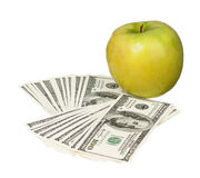 Dollars and apple Stock Photo