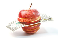 Dollars in apple Stock Photo