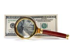 Dollars avec la loupe Photographie stock