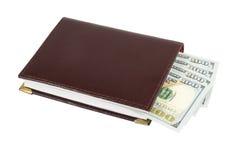 Dollars avec le livre Photographie stock