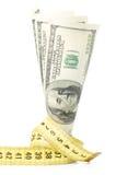Dollars avec le mètre jaune photographie stock libre de droits