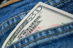 Dollars in back pocket Stock Photos
