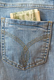Dollars in the back pocket of jeans Royalty Free Stock Images