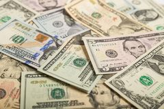 Dollars background. Background of different dollar bills Stock Photo