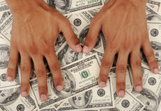 Dollars background, human hands Royalty Free Stock Image