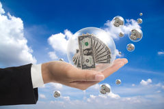 Dollars in the ball. Stock Images