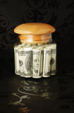 Dollars in bank. On a black background Stock Photos