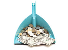 Dollars banknote with coins in blue dustpan Stock Photos