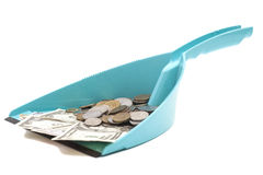 Dollars banknote with coins in blue dustpan Royalty Free Stock Photo