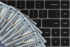 Free Dollars Banknotes And Black Laptop Keyboard Stock Image - 114799731