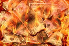 Dollars Banknotes or bills of United States of America dollars burning in flame concept of crisis, loss, recession failure. Dollars Banknotes or bills of United royalty free stock images