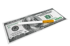 Dollars banknotes with Cigarette. Expensive habit and No Smoking concept. Dollars banknotes with cigarette on a white background royalty free stock photo