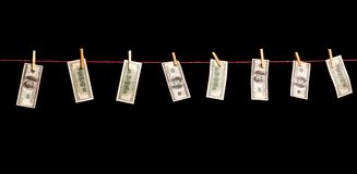 Dollars banknotes are hanging on a rope Royalty Free Stock Photography