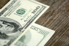 Dollars banknotes on wooden background Stock Images