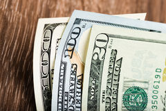 Dollars banknotes on the wooden table Stock Photos