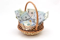 Dollars. Basket of dollars on a white background Royalty Free Stock Photos