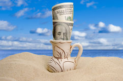 Dollars on a beach Royalty Free Stock Photography