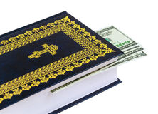 Dollars on the Bible Royalty Free Stock Image