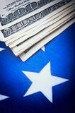 Dollars bills on flag Royalty Free Stock Photo