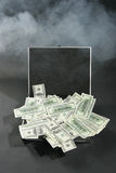 Dollars bills in opened suitcase Stock Photos