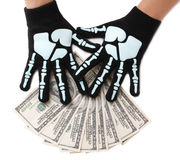 Dollars bills and skeleton hands Royalty Free Stock Photo