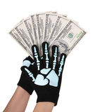 Dollars bills in skeleton hands isolated on white Royalty Free Stock Photos