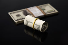 Dollars on a black background Stock Photo
